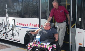 City of Coolidge Transit Manager Michael Meyer assists Aessa, a regular customer on CART, with ease on the 1:6 ramp.