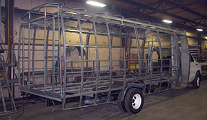 Ameritrans says it is the only small bus OEM to extend the steel cage structure below the floor line. Ameritrans' extends below the floor line and behind the skirt.