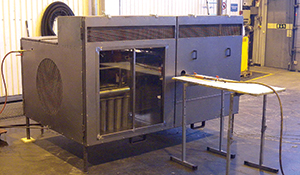 This mock-up of an engine compartment tests the performance of the suppression system under different driving conditions. Tests include both small and large fires under varying conditions of air flow, temperature and size of ventilation openings in the test rig.