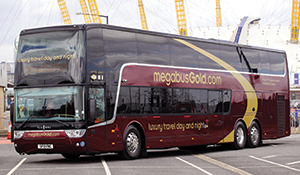 A megabus.com gold double-decker sleeper coach in the United Kingdom. They are longer than the US specification because of higher European axle weight limits.