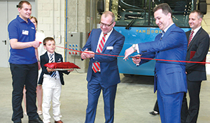 CEO Filip Van Hool cuts the ribbon at the opening of the new Van Hool plant.