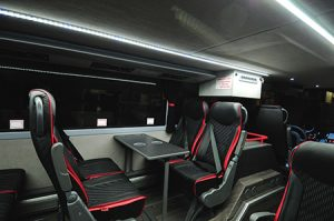 The test coach is custom outfitted with onboard Wi-Fi, worktables and Grand Luxe leather seats, with USB ports and 110v at each seat.