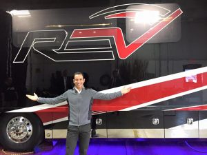 Three-time Indianapolis 500 winner Helio Castroneves with a REV RV.