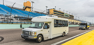 LF Transport and Krystal luxury bus showing their safety and maneuverability on the Homestead Miami Speedway.