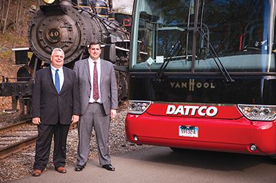Don DeVivo (left) and Kyle DeVivo (right) with their 100th Van Hool coach next to Valley Railroad Company's  iconic Essex Steam Train in Essex, CT.