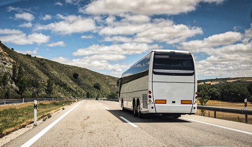 Coach, long haul bus, drives through Spain